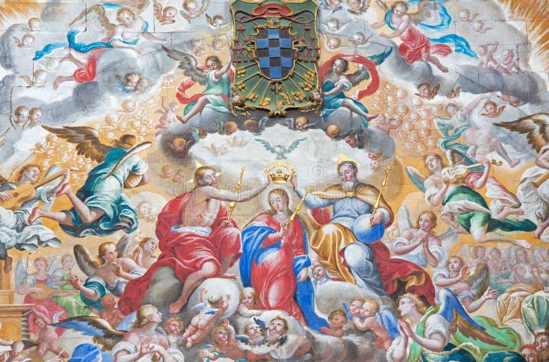 SALAMANCA, SPAIN: Fresco of Coronation of Virgin Mary in monastery Convento de San Esteban and Chapel of Rosary. SALAMANCA, SPAIN, APRIL - 16, 2016: The fresco stock photography