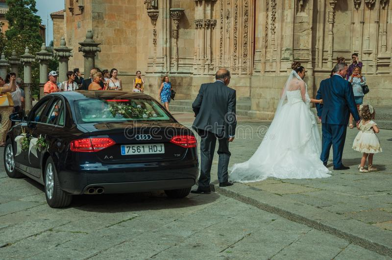 People looking at bride in front the New Cathedral at Salamanca. Salamanca, Spain - July 21, 2018. People looking at bride enter through the door of the New stock photos