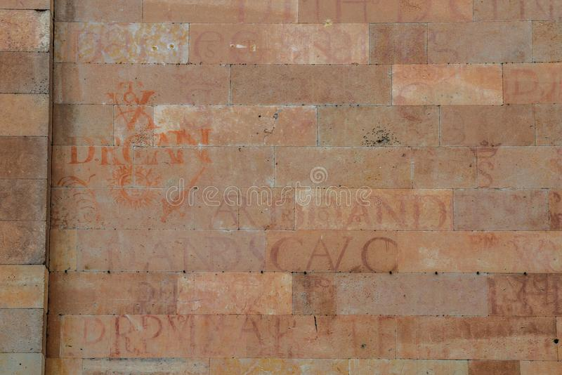 Ancient writing on a wall facade in the historic city centre of Salamanca, Spain royalty free stock photos