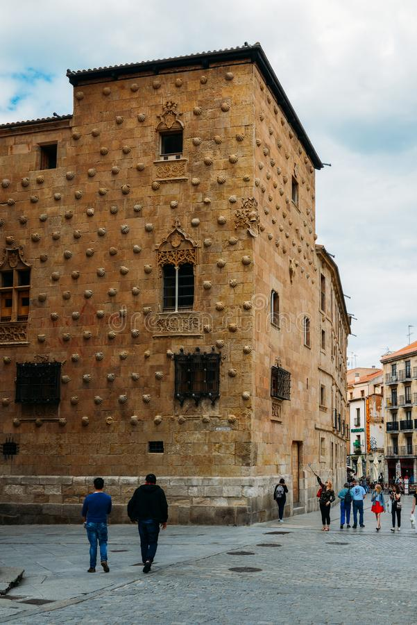 Facade to 16th-century Gothic palace covered in symbolic seashell motifs, now an exhibition space library, Salamanca royalty free stock photography