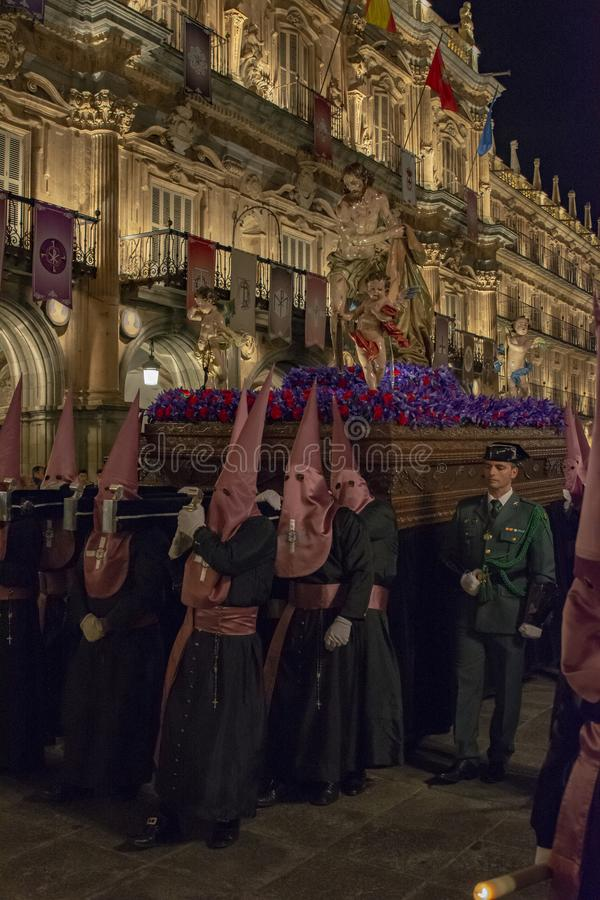 Holy Wednesday Procession in Salamanca, Spain. Salamanca, Spain; March 2017: Brotherhood of Our Father Jesus Flagelado and Our Lady of Tears, parading the night stock photography