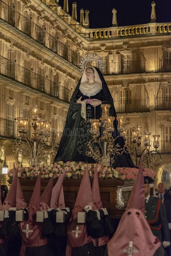 Holy Wednesday Procession in Salamanca, Spain. Salamanca, Spain; March 2017: Brotherhood of Our Father Jesus Flagelado and Our Lady of Tears, parading the night royalty free stock photo