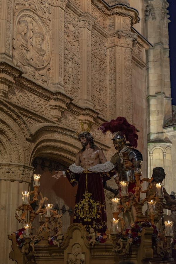 Processions through the streets of Salamanca , Spain. Salamanca, Spain; March 2017: Procession of the Hermandad de Penitencia de Nuestro Padre Jesús Despojado stock image