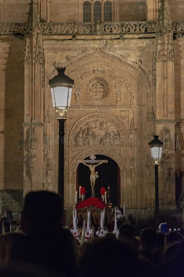 Holy Wednesday Procession in Salamanca, Spain. Salamanca, Spain; March 2017: Royal Confraternity of the Lying Christ of Mercy and Redemptive Agony, going out in royalty free stock images