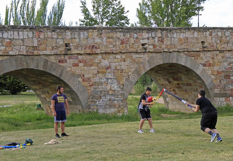 Adolescents are playing outdoor in public park of Salamanca. Salamanca, Spain - May 22, 2018: adolescents are playing outdoor in public park of Salamanca, Spain royalty free stock photos