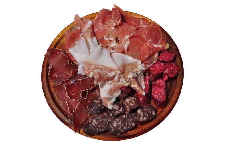 Salame della montagna, prosciutto e vassoio tradizionali italiani della salsiccia fotografia stock libera da diritti