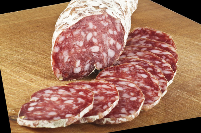 Salami avec des parts photos stock