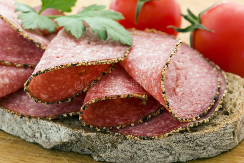 Salami bread. On Cutting Board stock photography