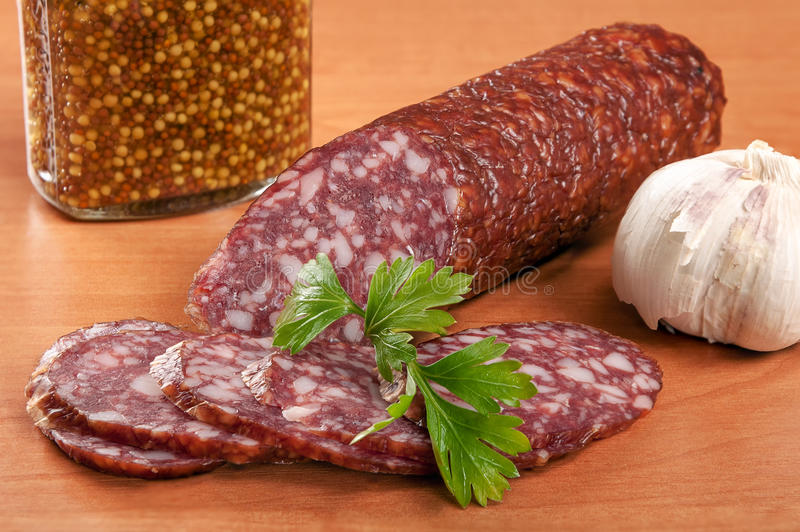 Salami for Breakfast with pepper on a wooden table royalty free stock photos