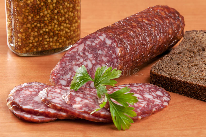 Salami for Breakfast with pepper on a wooden table stock photos