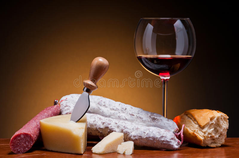 Salami, cheese and wine stock photos