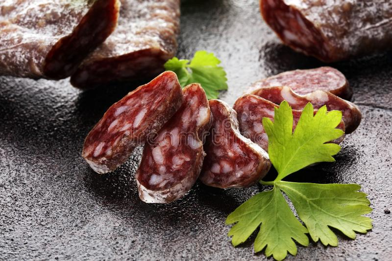 Salami cut. thinly sliced salami on a wooden texture on the background stock photography