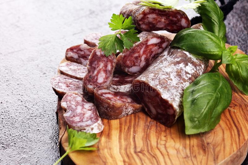 Salami cut. thinly sliced salami on a wooden texture on the background stock images