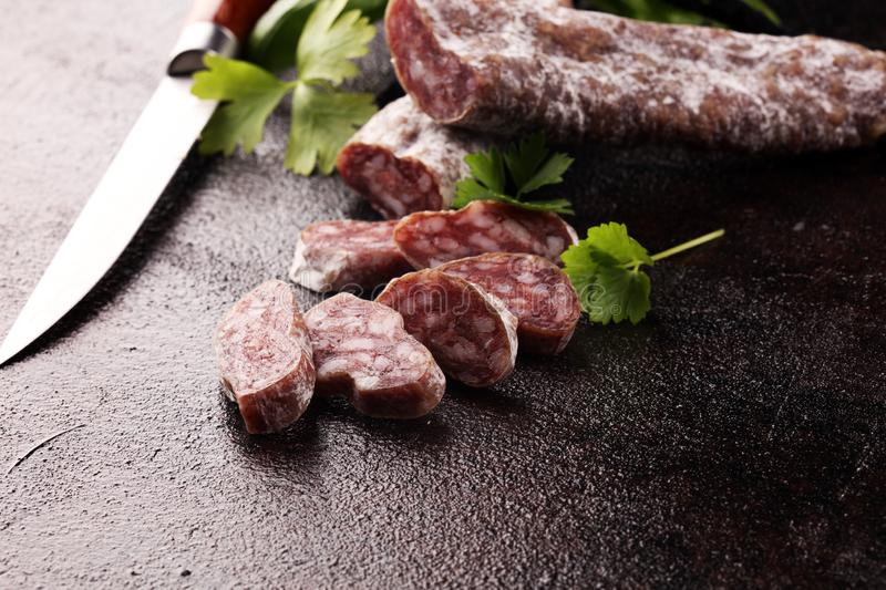Salami cut. thinly sliced salami on a wooden texture on the background stock photos