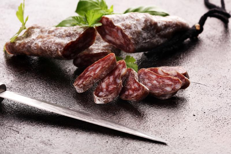 Salami cut. thinly sliced salami on a wooden texture on the background royalty free stock photos