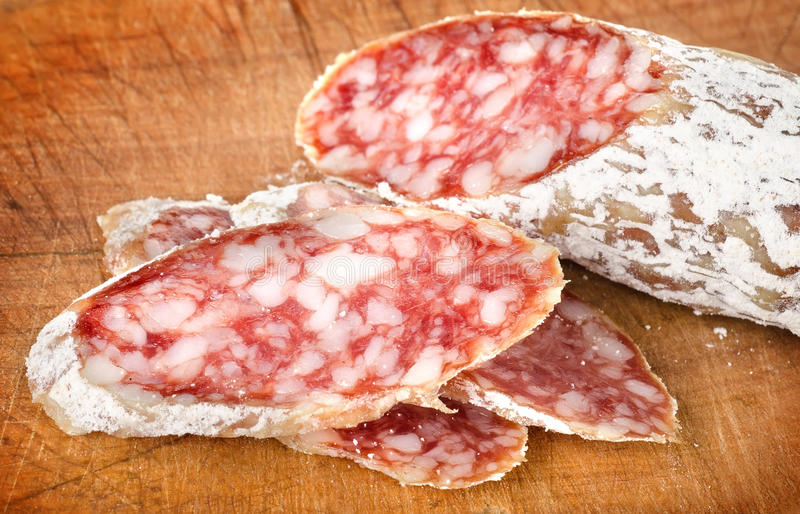 Download Salami on a cutting board stock image. Image of cold - 26624777