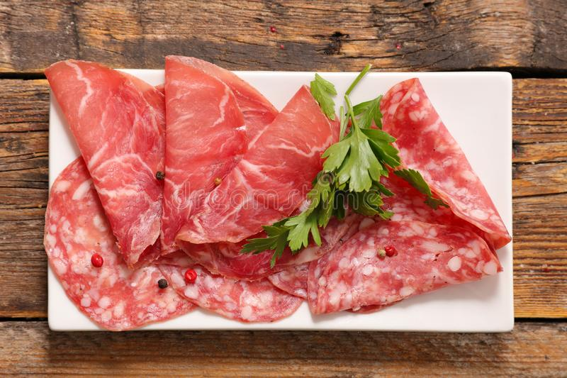 Salami en bacon stock afbeelding