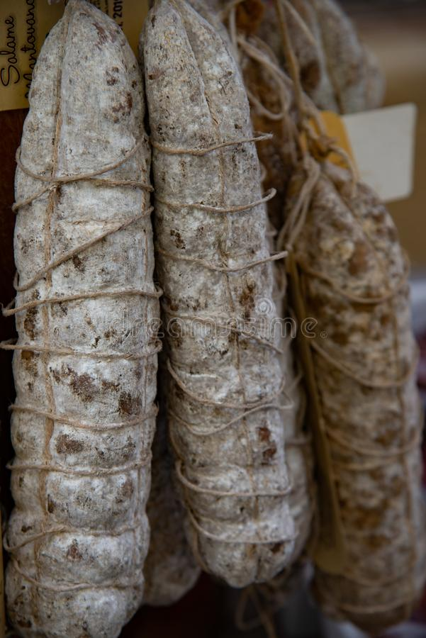 Salami hanging to be sold Sopressa veronese, Italy. Sausage cured and seasoned pork royalty free stock image