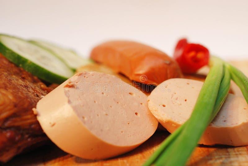Salami met vage achtergrond stock foto's