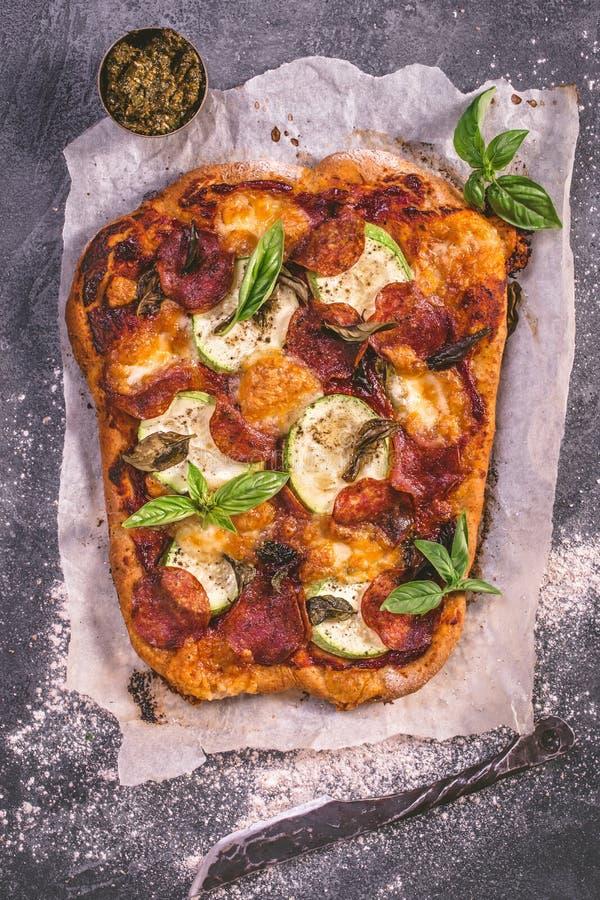 Salami and mozzarella pizza above stock photography