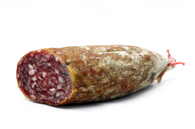 Salami over white. Piece of italian rustic salami royalty free stock photography