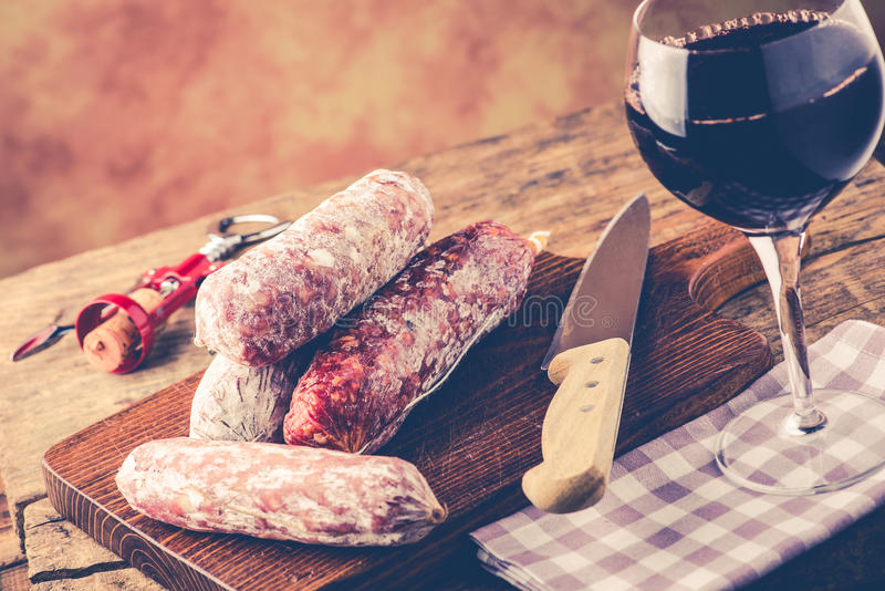 Salami and red wine. Italian food concept royalty free stock photography
