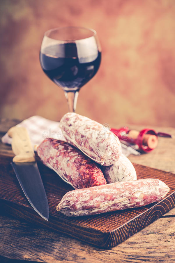 Salami and red wine. Italian food concept royalty free stock photo