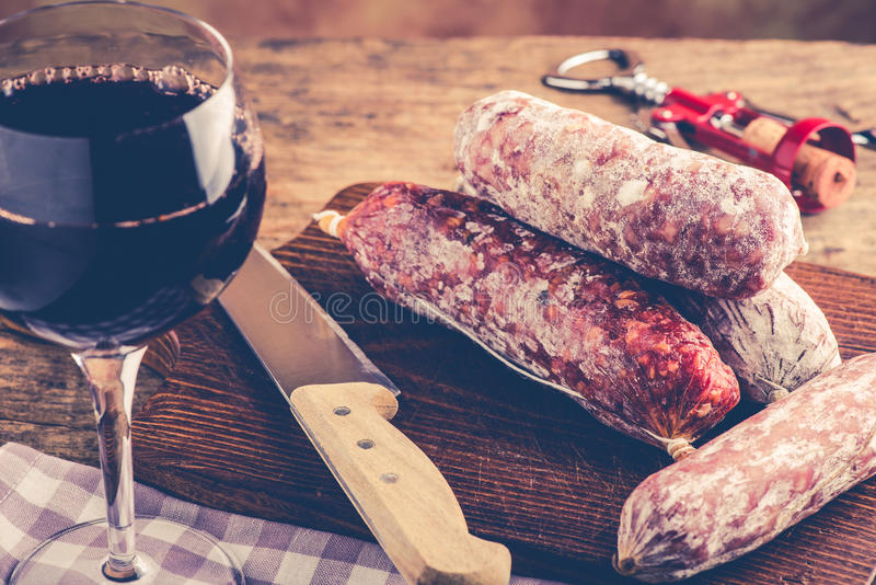 Salami and red wine. Italian food concept royalty free stock images