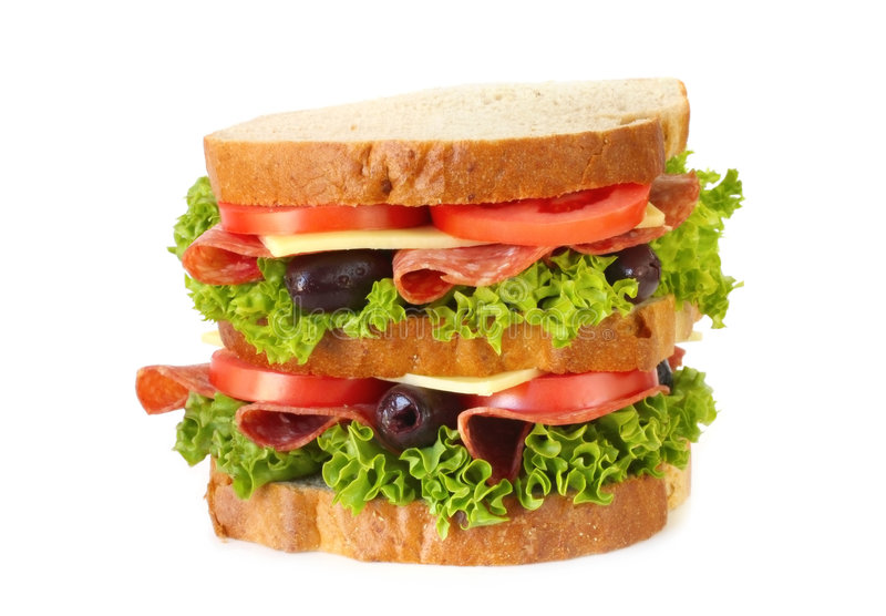 Salami Sandwich. Triple-decker salami sandwich, with curly lettuce, tomatoes, cheese and black olives. Isolated on white stock photo