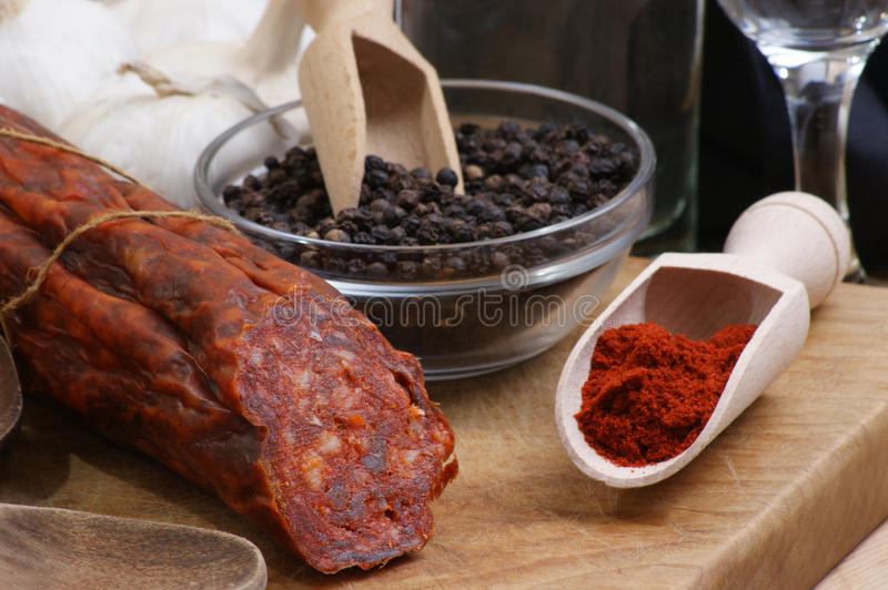 Salami and some spice royalty free stock images