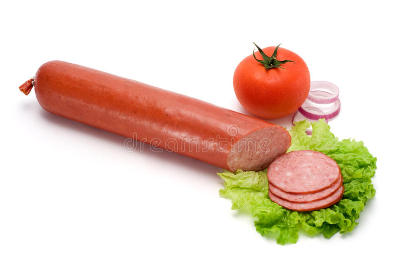 Salami stick and slices. With vegetables royalty free stock photos