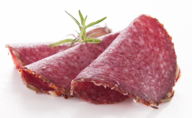Salami. Tasty sliced salami with spices stock photo
