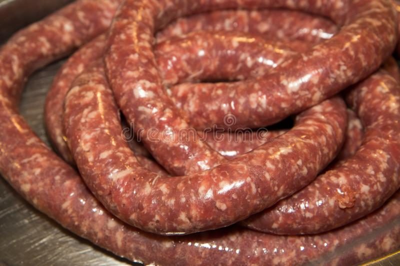 Salami is a type of cured sausage consisting of fermented and air-dried meat, typically beef or typical products of Emilia Romagna. Salami is a type of cured royalty free stock photo