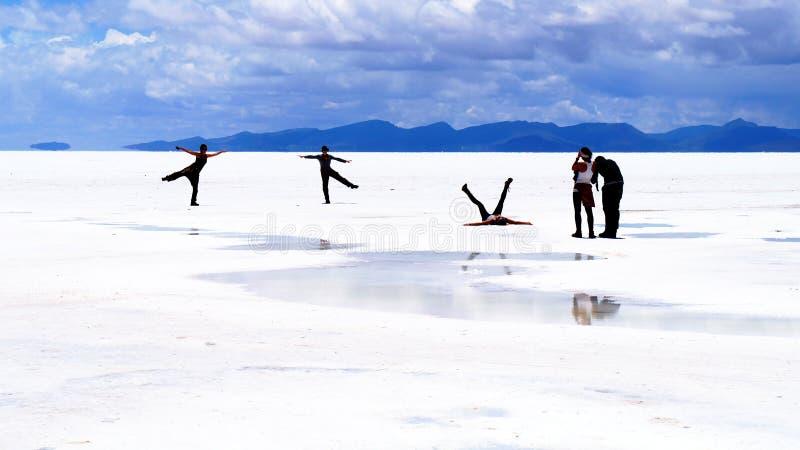 Salar de Uyuni Bolivia salt desert - people posing stock photography