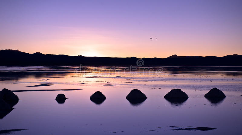 Salar de Uyuni. In Bolivia, sunrise, pyramids of salt royalty free stock images