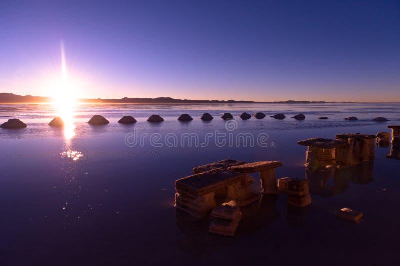 Salar de Uyuni. In Bolivia, sunrise, pyramids of salt royalty free stock photo