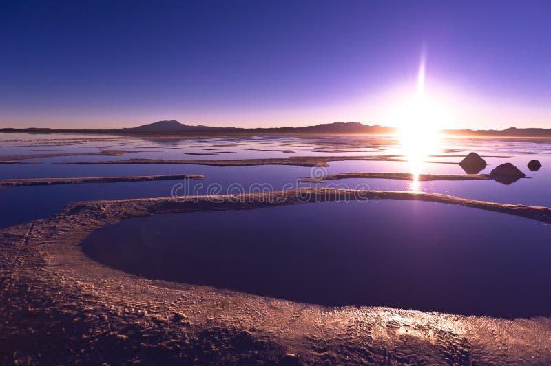 Salar de Uyuni. In Bolivia, sunrise, pyramids of salt royalty free stock image