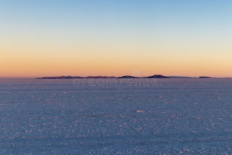 Salar de Uyuni Salt Flat bij zonsondergang, Bolivië stock fotografie