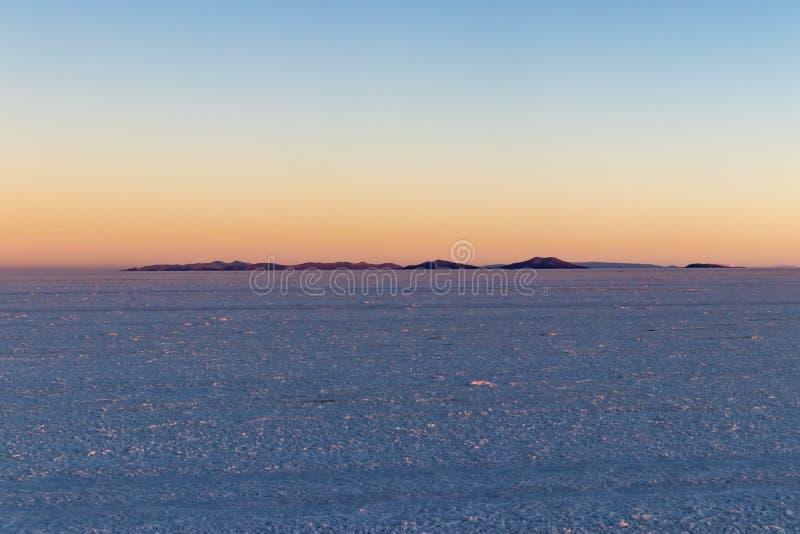 Salar de Uyuni Salt Flat no por do sol, Bolívia fotografia de stock