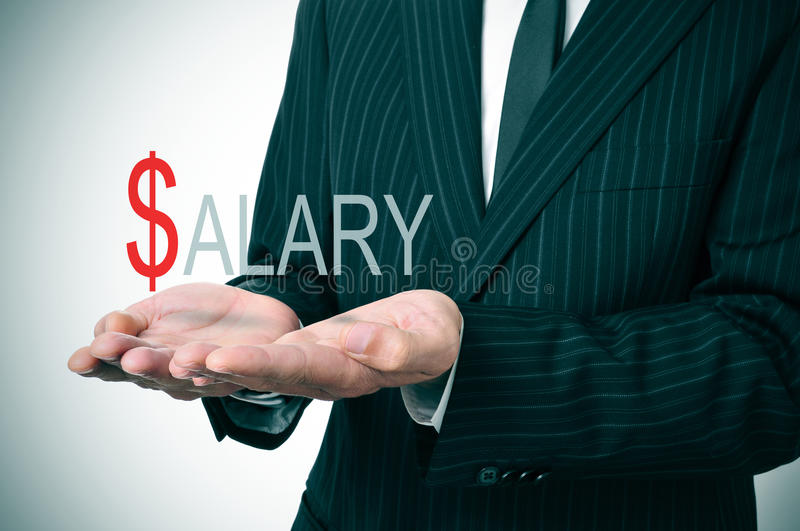 Salary. Man wearing a suit holding the word salary in his hands royalty free stock photography