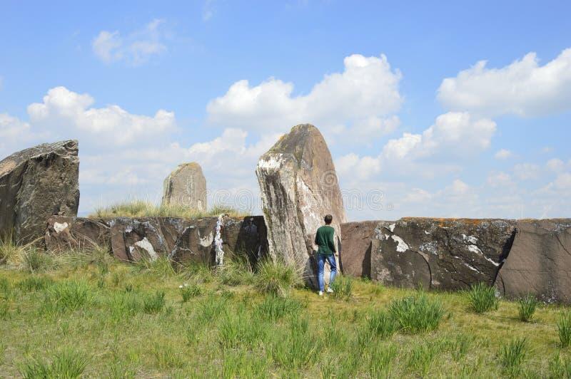 Salbykskiy mound. Ancient stones in the Khakass steppe. Russia. Khakassia stock image