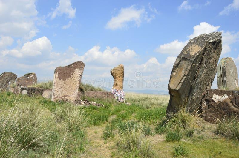 Salbykskiy mound. Ancient stones in the Khakass steppe. Russia. Khakassia royalty free stock photography
