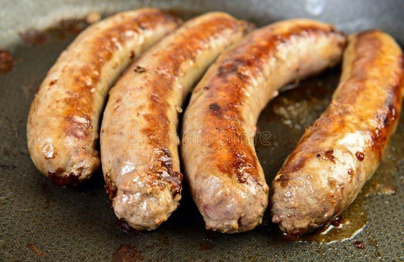 Salchicha de cerdo cocinada imagenes de archivo