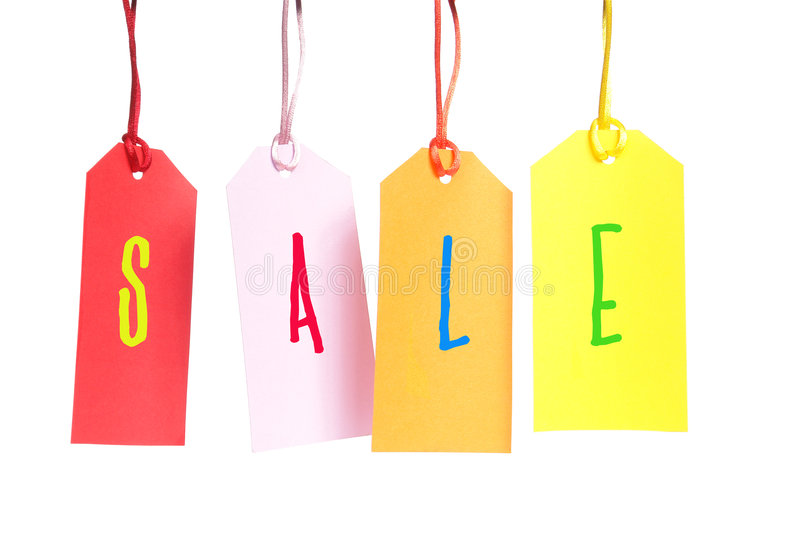 Sale. Four color shopping tags spelling SALE over white background royalty free stock photos