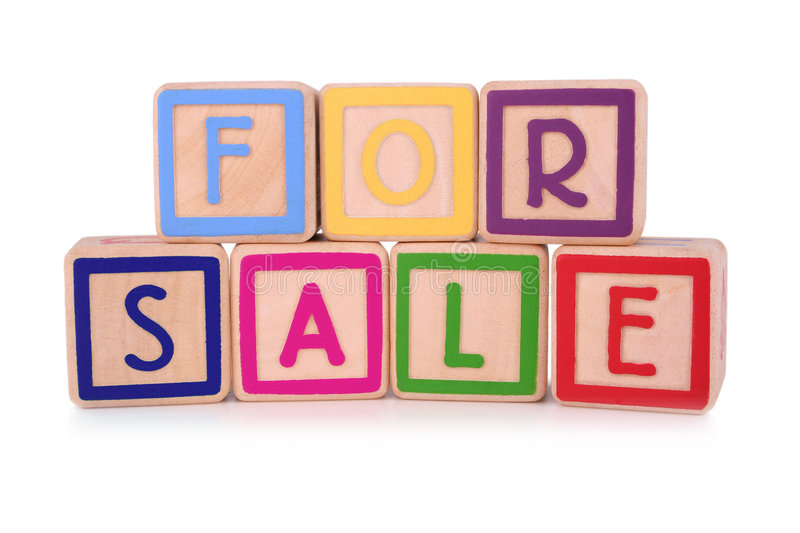 For sale. Isolated children's building blocks spelling the words for sale stock image