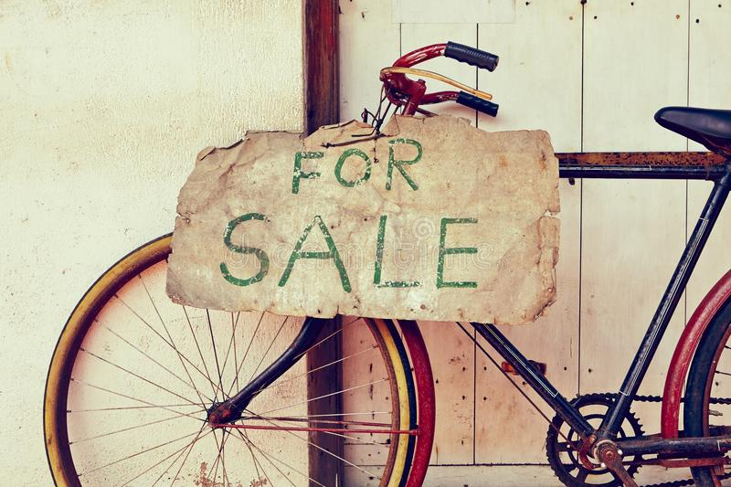For sale. Abandoned bicycle for sale - retro color stock photo
