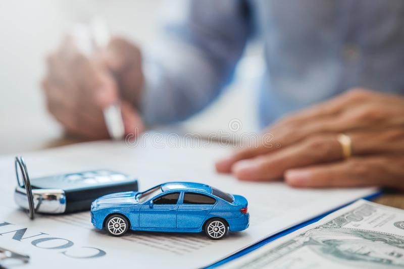 Sale agent  deal to agreement successful car loan contract with customer and sign agreement contract  Insurance car concept stock photography
