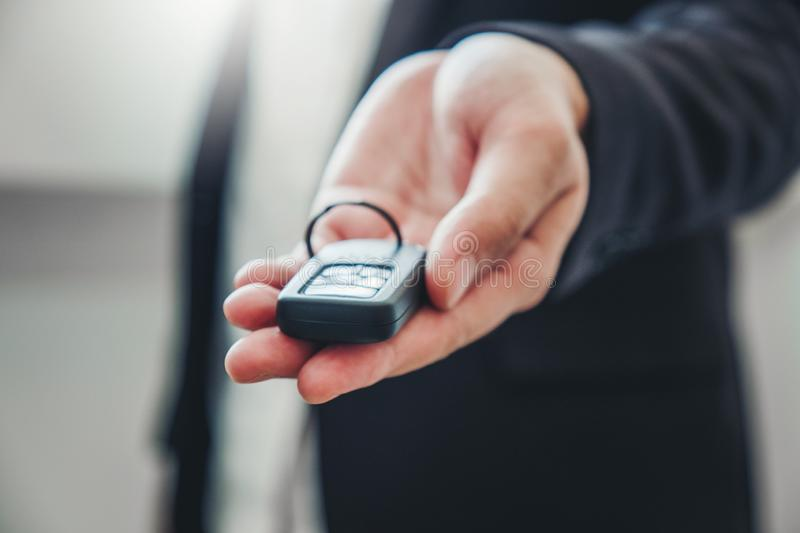 Sale agent giving Car key to customer and sign agreement contract, Insurance car concept stock photos