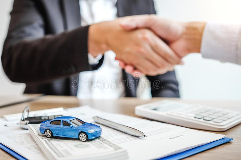 Sale agent handshake deal to agreement successful car loan contract with customer and sign agreement contract  Insurance car stock image