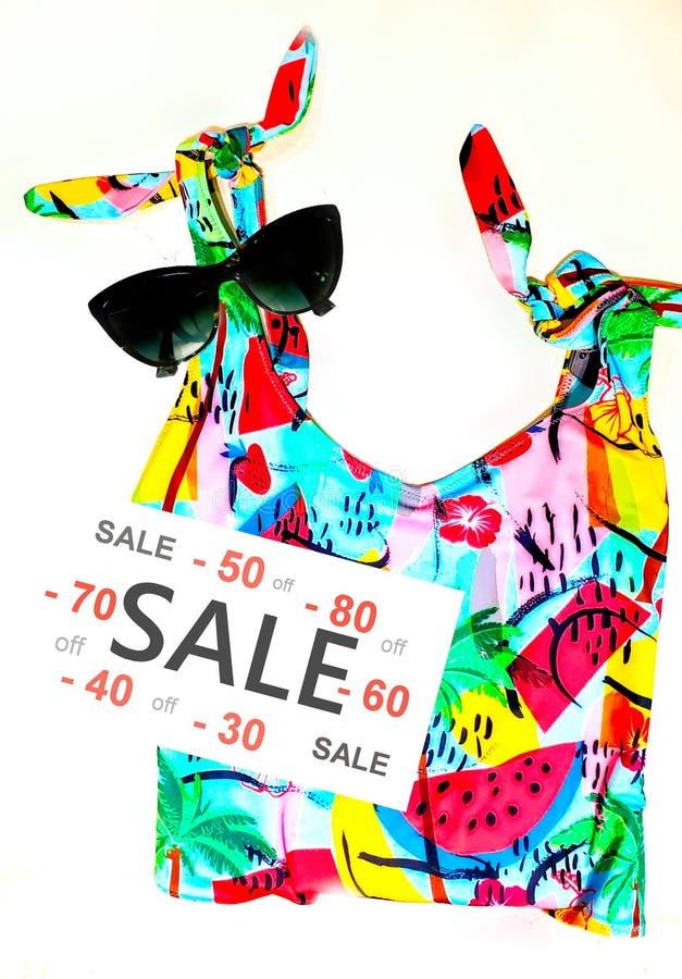 Sale banner season big discount less price woman shopping summer sale. Women dresses and bikini with sunglass Sale banner season big discount less price woman royalty free stock photography